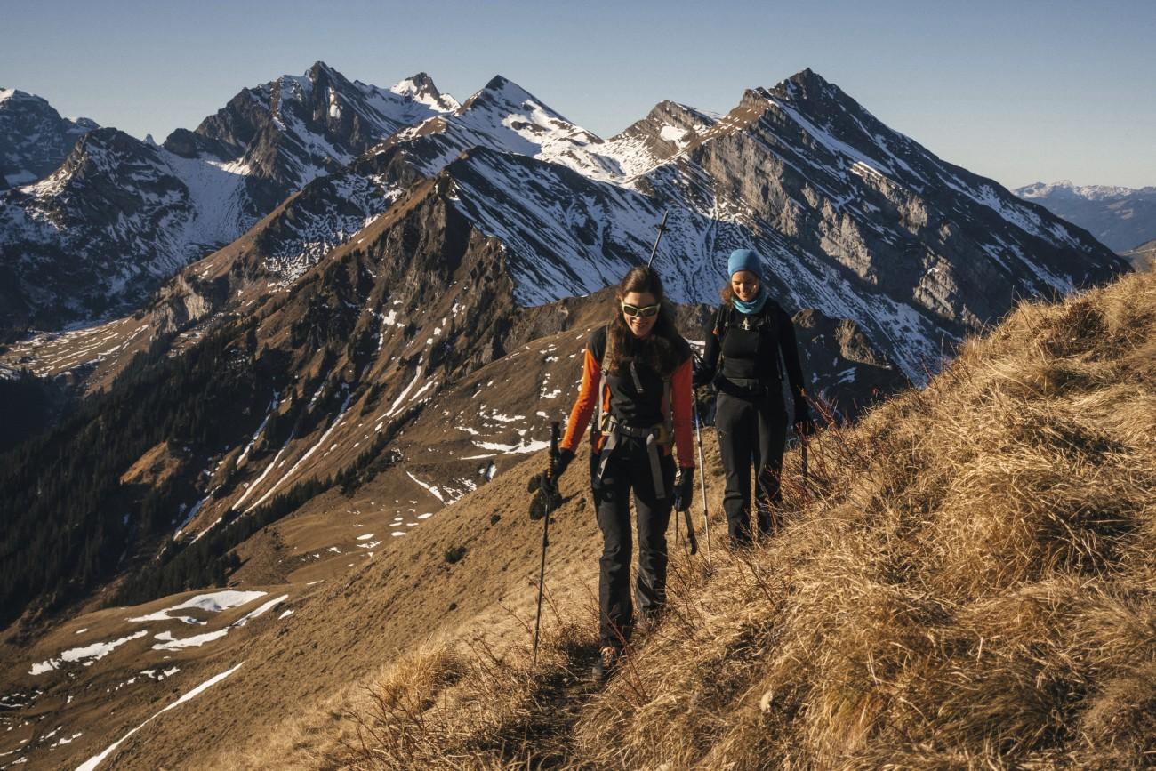 Female-mountaineers-moving-up-mountain-ridge-1066621808_3869x2579.jpg