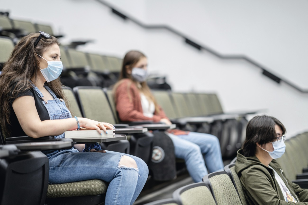 Group-of-university-students-wearing-masks-in-class-1267681188_2125x1417.jpg